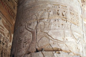 Medinet-Habu-atef-smiting-Egypt