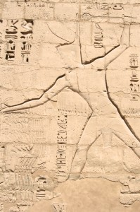 Medinet-Habu-red-crown-smiting-pylon-Egypt