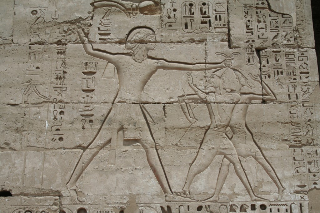 Medinet-Habu-sandals-smiting-Egypt
